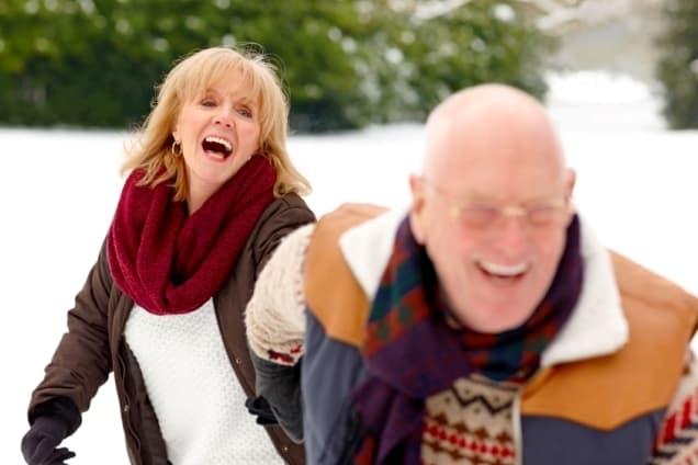 Couple-Enjoying-the-Snow