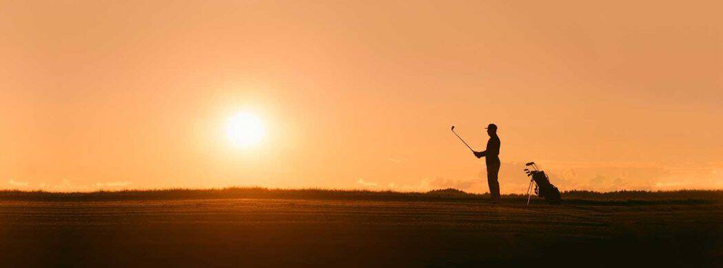 Sunsetting on golfer after their swing