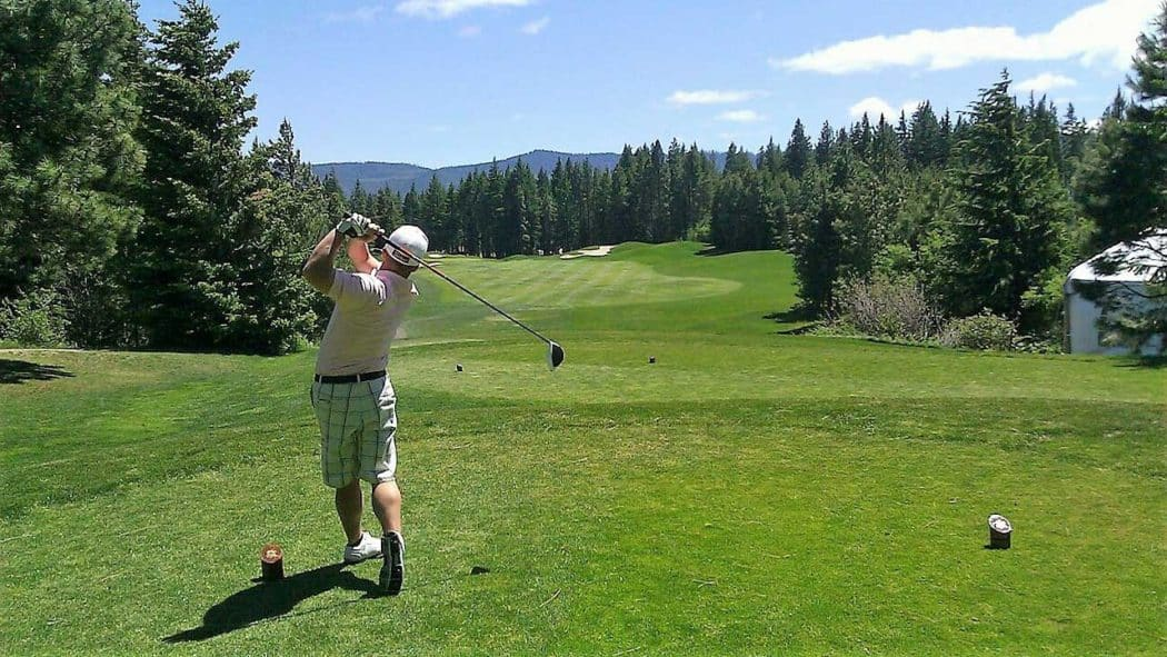 Golfer mishits the ball causing it to slice off to the right or left