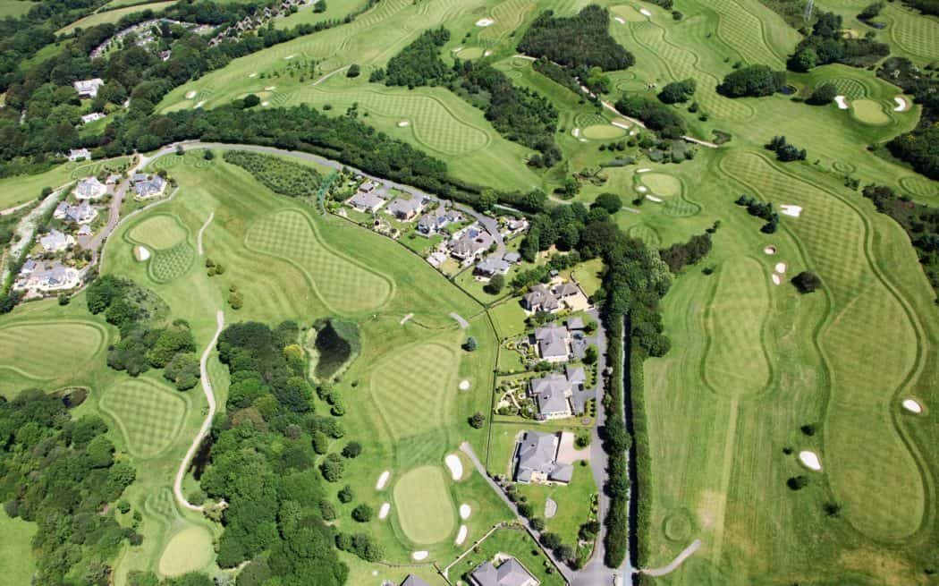A birdseye view of a housing community on a golf course